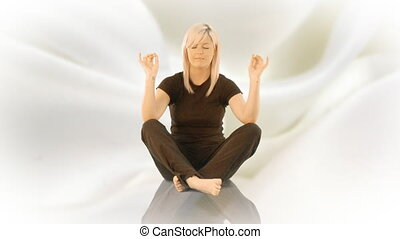 Woman practicising Yoga on her own - Young Woman practicing...