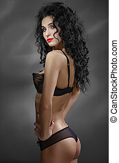 Portrait of sexual girl. Long black hair curls. Perfect...