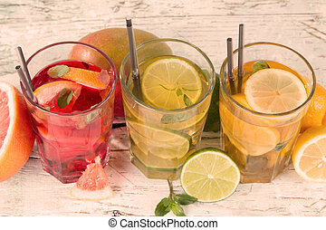 Summer drinks on wooden table. Ice team with fruits.