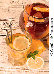ice tea - Lemon, slice and mint ice tea isolated on white...