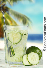 ice tea - Cucumber, slice and mint ice tea on wooden...
