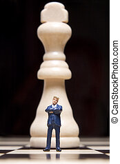Business Figurine and chess - Business figure Placed on a...