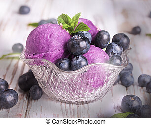 Ice cream blueberry on wodeen table with fruits