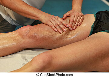 massaging athlete s thigh - hands massaging athlete s thigh...