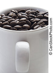 coffee beans - Coffee cup full of coffee beans on white