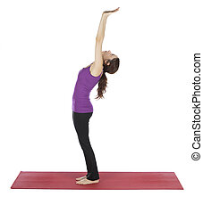 Woman doing Tadasana during moon yoga flow - Young woman is...