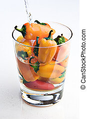Red peppers in a glass