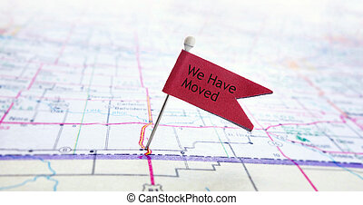 We Have Moved - Closeup of red pin flag on a map with We...