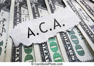 aca - ACA - Affordable Care Act text on cash...