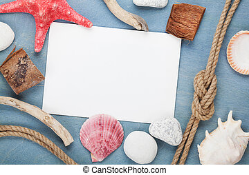 Blank paper card with seashells, ship rope, sea stones
