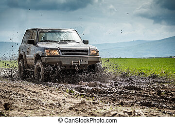 Off-road vehicle splashed mud