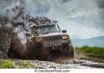 Off road car sprays mud