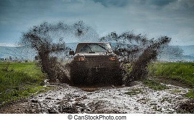 Off road car in muddy road