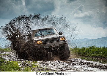 Jeep off road in muddy conditions