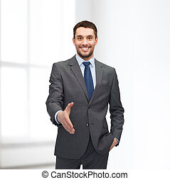 businessman with open hand ready for handshake - business...