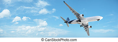 Jet in a blue cloudy sky Panoramic composition