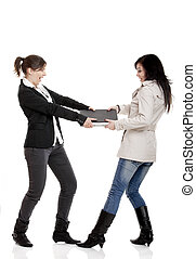 Fighting for a laptop - Two young women Fighting for a...