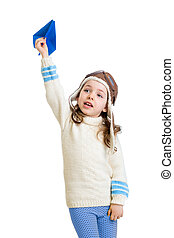 kid girl dressed as pilot and playing with paper airplane isolated on white background
