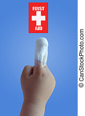 First Aid - Finger of a children with first aid