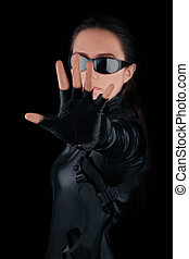 Woman Guard Stop Hand Gesture - Woman in black leather suit...
