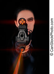Woman Spy Aiming Gun with Laser - Woman in a black leather...