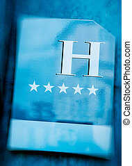 Five star hotel sign entrance - Five stars hotel sign of a...