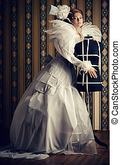 sewing - Beautiful fashion model in the refined white dress...