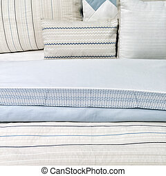 Elegant blue bed linen - Bed with elegant blue bed linen and...