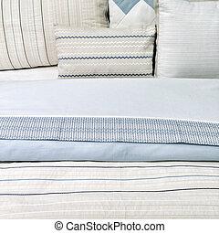 Elegant blue bed linen - Bed with elegant blue bed linen and...