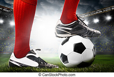 legs of a soccer player - legs of a soccer or football...