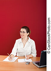 Businesswoman - Portrait of a young business woman sitting...