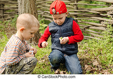 Two young boys playing with matches - Two young boys...