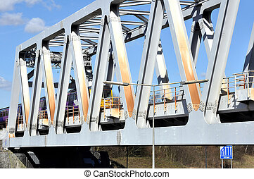 Truss Type Railway Bridge - A commuter train passing over a...