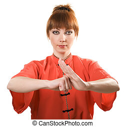 young woman makes chinese greeting gesture isolated with...