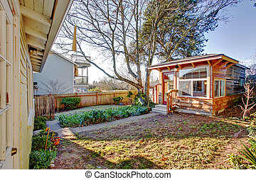 Backyard with small wooden shed - Fenced backyard with...