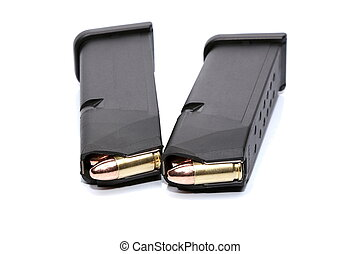 Two 9mm magazines and ammo on white background