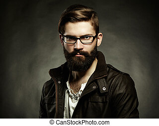 Portrait of man with glasses and beard. Close-up