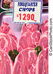 Lamb forequarter chops on display in the market.