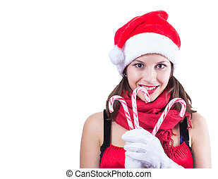 Beautiful woman in Santa Claus clothes over white background with candy