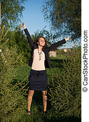 Happy woman with raised arms at