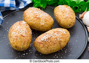 Jacket potato - Freshly baked jacket potato on a plate