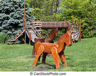 playground with wooden horses