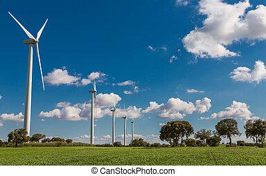 Wind turbines - Modern Wind turbines large array on a cloudy...