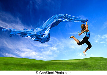 Big Jump - Beautiful athletic woman jumping on a green...
