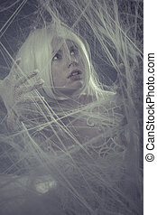 Spider web trapped, Sensual lady in white corset, long hair,...