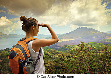 Woman traveler looking at Batur volcano Indonesia