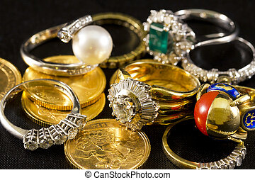 Precious jewels, rings with diamonds, emeralds and corals on...