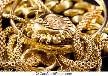 Gold Jewelry - Closeup of yellow gold jewelery on a black...