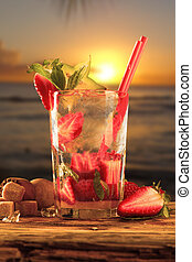 Drink - Summer strawberry drink. Cocktail on wooden table...