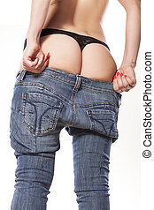 narrow trouble - girl trying to dress her tight jeans